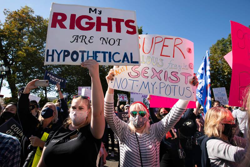 Demonstrators rally at the Supreme Court, during the Women's March in Washington, Saturday, Oct. 17, 2020. (AP Photo/Jose Luis Magana)
