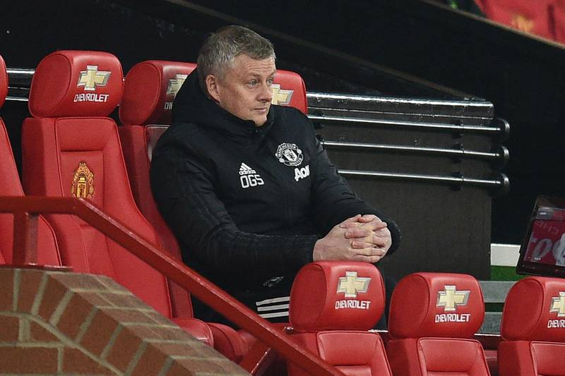 Manchester United's Norwegian manager Ole Gunnar Solskjaer watches from his seat during the English FA Cup third round football match between Manchester United and Watford at Old Trafford in Manchester, north west England, on January 9, 2021. (Photo by Oli SCARFF / POOL / AFP) / RESTRICTED TO EDITORIAL USE. No use with unauthorized audio, video, data, fixture lists, club/league logos or 'live' services. Online in-match use limited to 120 images. An additional 40 images may be used in extra time. No video emulation. Social media in-match use limited to 120 images. An additional 40 images may be used in extra time. No use in betting publications, games or single club/league/player publications. /
