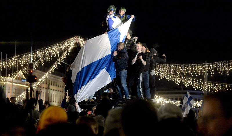 Finnish fans celebrate victory at a fountain in central Helsinki after the UEFA Euro 2020 Group J qualification football match between Finland and Liechtenstein in Helsinki, Finland, on November 15, 2019. - Finland has qualified for the first time for a major football tournament. (Photo by Mikko Stig / Lehtikuva / AFP) / Finland OUT