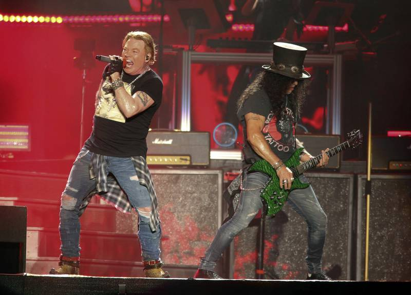 FILE - In this Oct. 4, 2019 file photo, Guns N' Roses' Axl Rose, left, and Slash perform on the first weekend of the Austin City Limits Music Festival at Zilker Park in Austin, Texas. Guns N' Roses, Maroon 5, DJ Khaled and DaBaby will perform at the second annual Bud Light Super Bowl Music Fest, to take place Jan. 30 through Feb. 1 at AmericanAirlines Arena in Miami. (Photo by Jack Plunkett/Invision/AP, File)