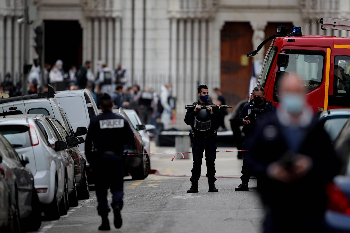Policemen stand guard near the scene of the knife attack at the Notre Dame church in Nice, France, Thursday, Oct. 29, 2020. An attacker armed with a knife killed three people at a church in the Mediterranean city of Nice, the third attack in two months in France. (AP Photo/Daniel Cole)