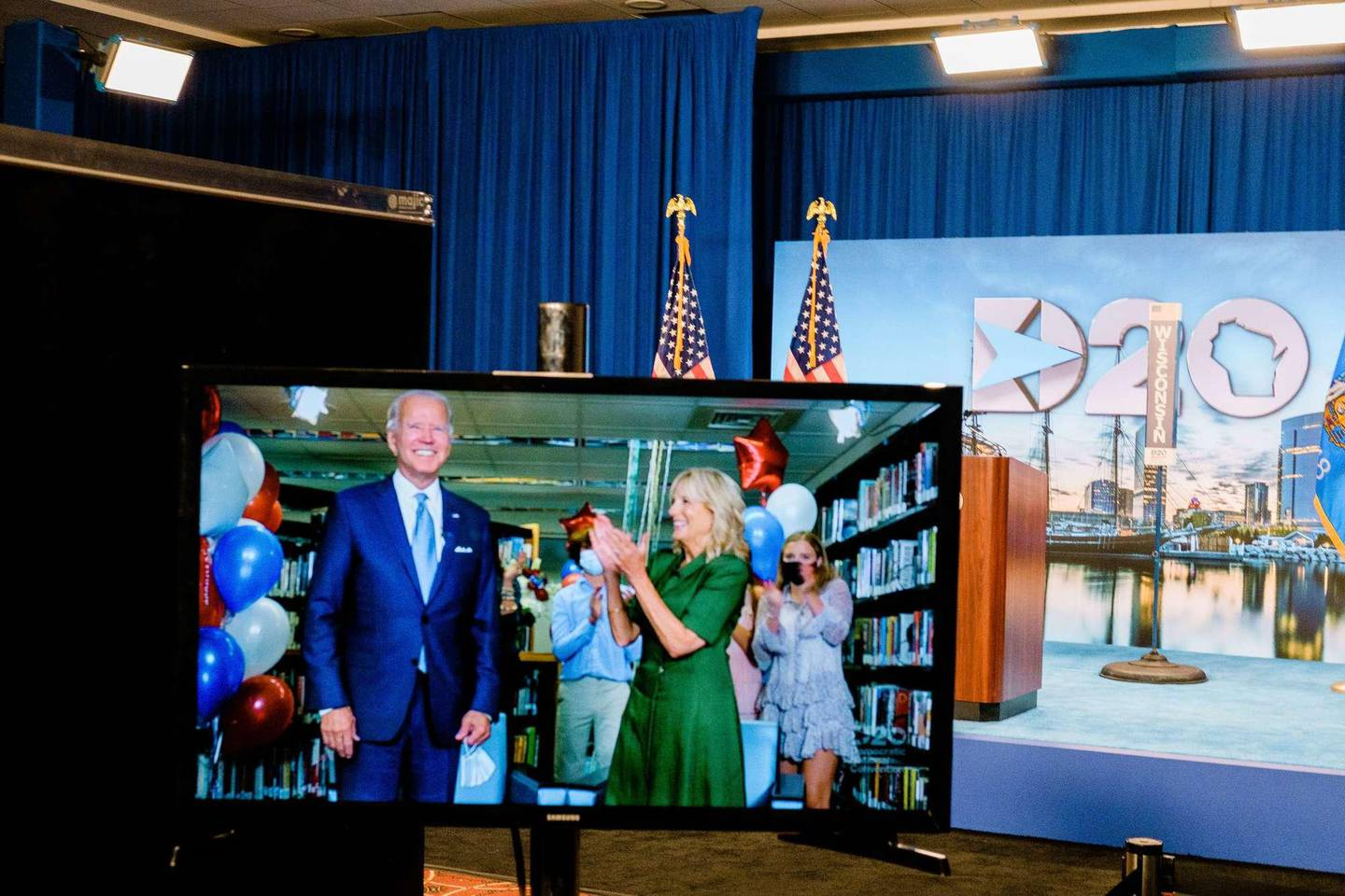 MILWAUKEE, WISCONSIN - AUGUST 18: Democratic presidential candidate Joe Biden and wife Dr. Jill Biden are seen in a video feed from Delaware after winning the votes to become the nominee on the second night of the 2020 Democratic National Convention at the Wisconsin Center on August 18, 2020 in Milwaukee, Wisconsin. The convention, which was once expected to draw 50,000 people to Milwaukee, Wisconsin, is now taking place virtually due to the coronavirus pandemic.   Gabriela Bhaskar-Pool/Getty Images/AFP == FOR NEWSPAPERS, INTERNET, TELCOS & TELEVISION USE ONLY ==