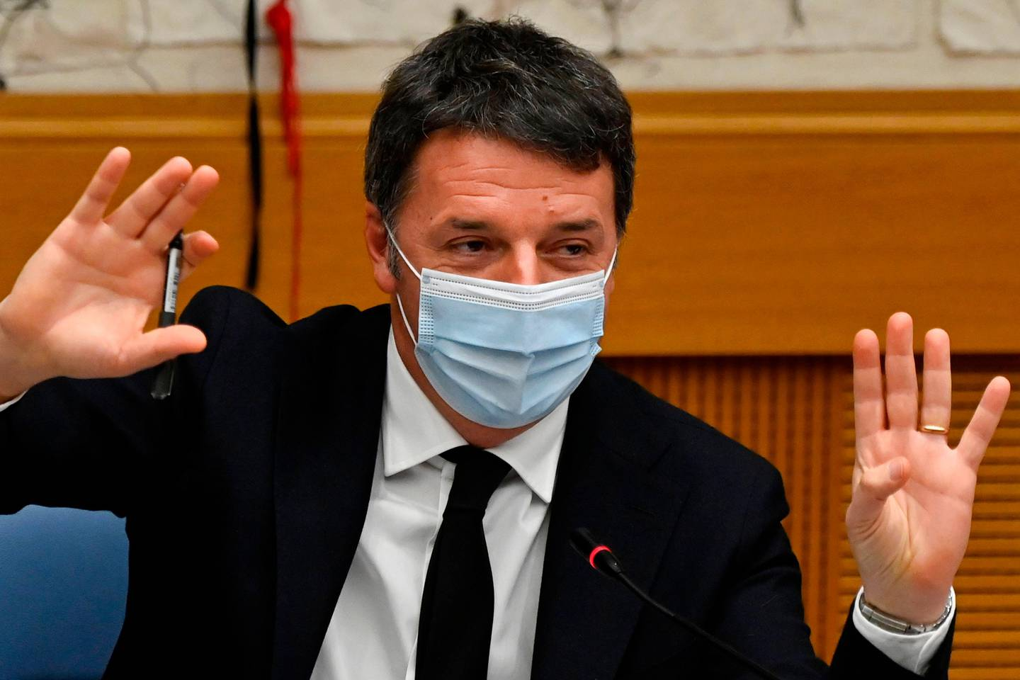 Italian current Senator, former premier and head of the political party 'Italia Viva' (IV), Matteo Renzi gestures as he holds a press conference on January 13, 2021 at the Italian Chamber of Deputies in Rome. - The Italian cabinet was in crisis on January 13, 2021 following the resignations of Teresa Bellanova and Elena Bonetti, members of former premier Matteo Renzi's Italia Viva party. (Photo by Alberto PIZZOLI / POOL / AFP)