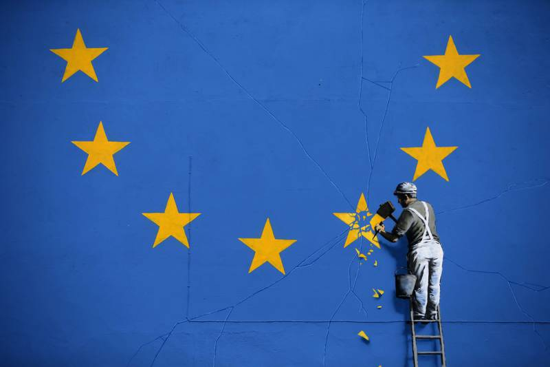 -- AFP PICTURES OF THE YEAR 2017 --   A recently painted mural by British graffiti artist Banksy, depicting a workman chipping away at one of the stars on a European Union (EU) themed flag, is pictured in Dover, south east England on May 8, 2017. / AFP PHOTO / Daniel LEAL-OLIVAS