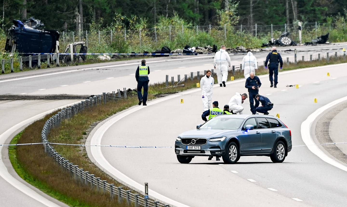 Police investigators at the scene where Lars Vilks and two bodyguards died in a car accident, on the E4 in Småland