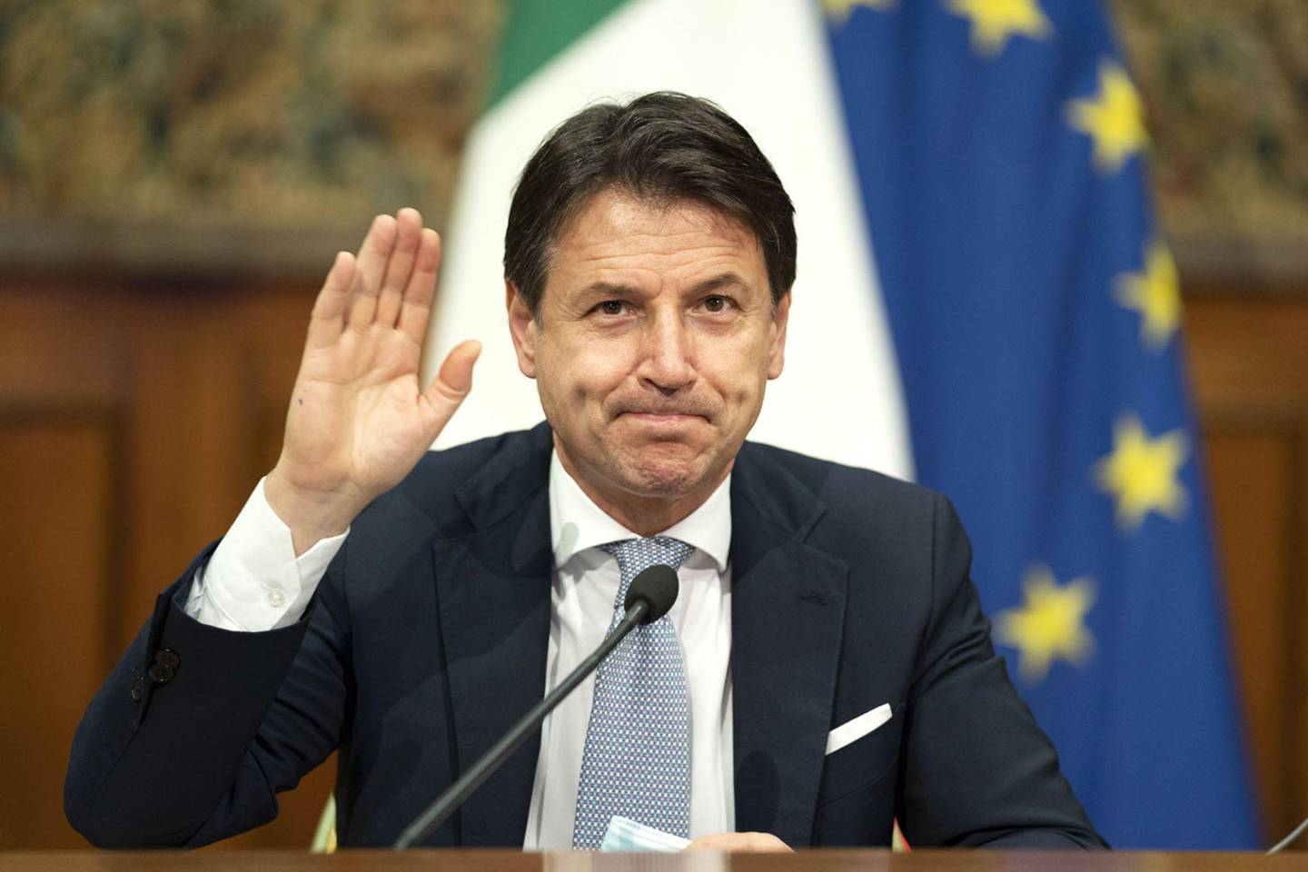 This handout photo taken in Rome on November 19, 2020 and released by the Italian Prime Minister's press office shows Prime Minister Giuseppe Conte during a video conference meeting with members of the European Council on the EU response to the COVID-19 pandemic. (Photo by - / Italys' Prime Minister Press Office / AFP)