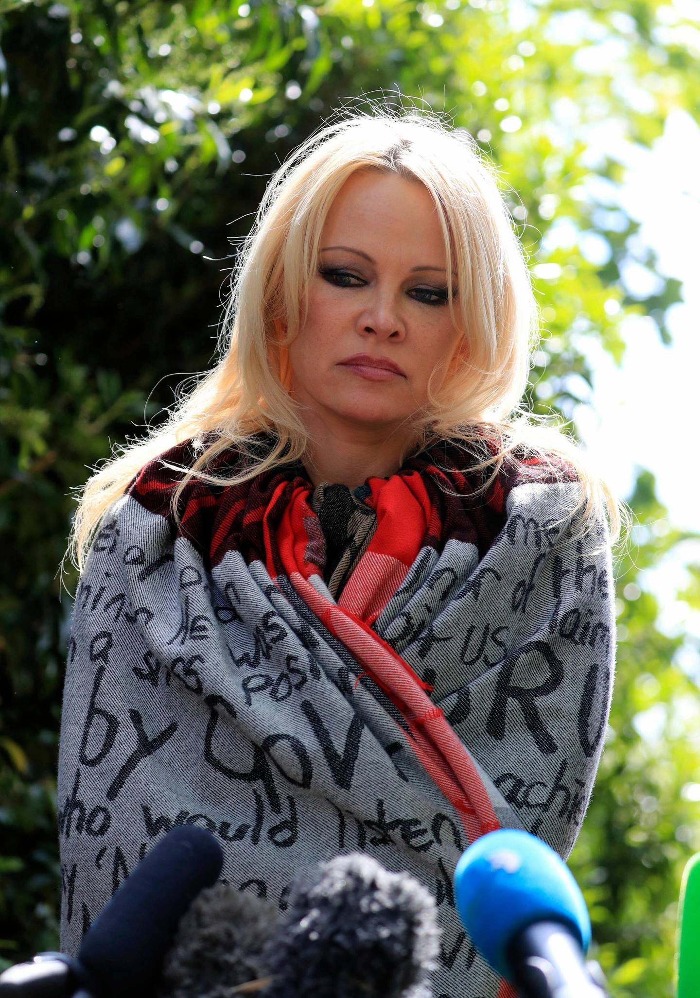 US actress Pamela Anderson speaks to the media outside Belmarsh Prison in south-east London, after visiting WikiLeaks founder Julian Assange, Tuesday May 7, 2019. (Gareth Fuller/PA via AP)