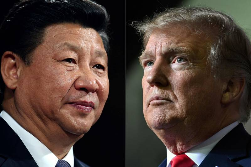 (FILES) This file combination of pictures created on May 14, 2020 shows recent portraits of   China's President Xi Jinping (L) and US President Donald Trump. - Donald Trump pleaded with China's leader Xi Jinping for help to win re-election in 2020, the US president's former aide John Bolton writes in an explosive new book, according to excerpts published June 17. (Photos by Dan Kitwood and Nicholas Kamm / AFP)