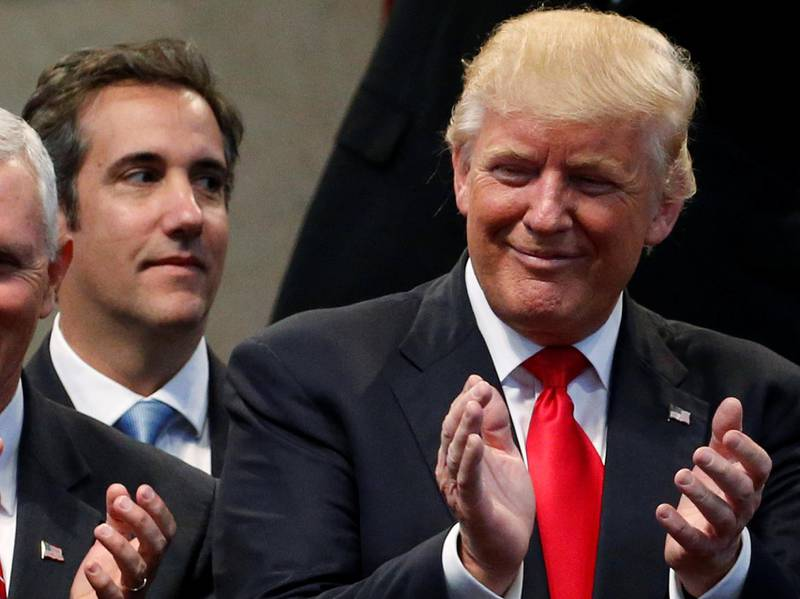 Republican presidential nominee Donald Trump's personal attorney Michael Cohen stands behind Trump after a group of supporters plus vice presidential nominee Mike Pence laid hands on Trump in prayer during a campaign stop at the New Spirit Revival Center church in Cleveland Heights, Ohio, U.S. September 21, 2016. Picture taken September 21, 2016. REUTERS/Jonathan Ernst