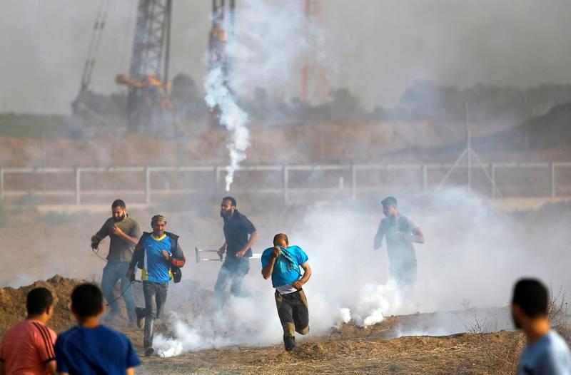 70 ÅR: Mens Israel feiret landets nasjonaldag og 70-årsjubileum for statens opprettelse i 1948, demonstrerte palestinere på grensen til Gaza-stripen. FOTO: MOHAMMED ABED/NTB SCANPIX