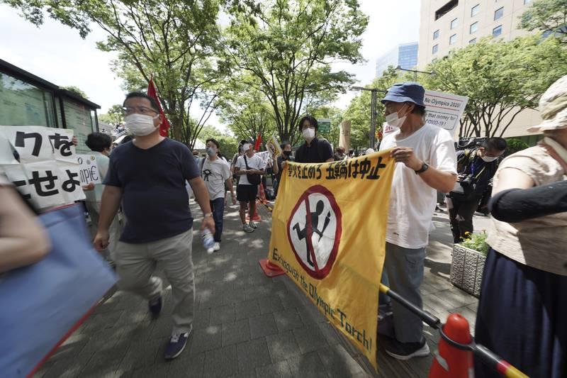 Lokale innbyggere i Tokyo krever OL-stopp. Foto: AP Photo / Kantaro Komiya
