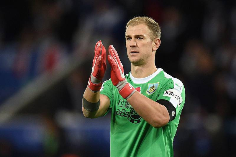 Burnley's English goalkeeper Joe Hart applauds the fans following the English Premier League football match between Leicester City and Burnley at King Power Stadium in Leicester, central England on November 10, 2018. - The match ended in a draw at 0-0. (Photo by Oli SCARFF / AFP) / RESTRICTED TO EDITORIAL USE. No use with unauthorized audio, video, data, fixture lists, club/league logos or 'live' services. Online in-match use limited to 120 images. An additional 40 images may be used in extra time. No video emulation. Social media in-match use limited to 120 images. An additional 40 images may be used in extra time. No use in betting publications, games or single club/league/player publications. /