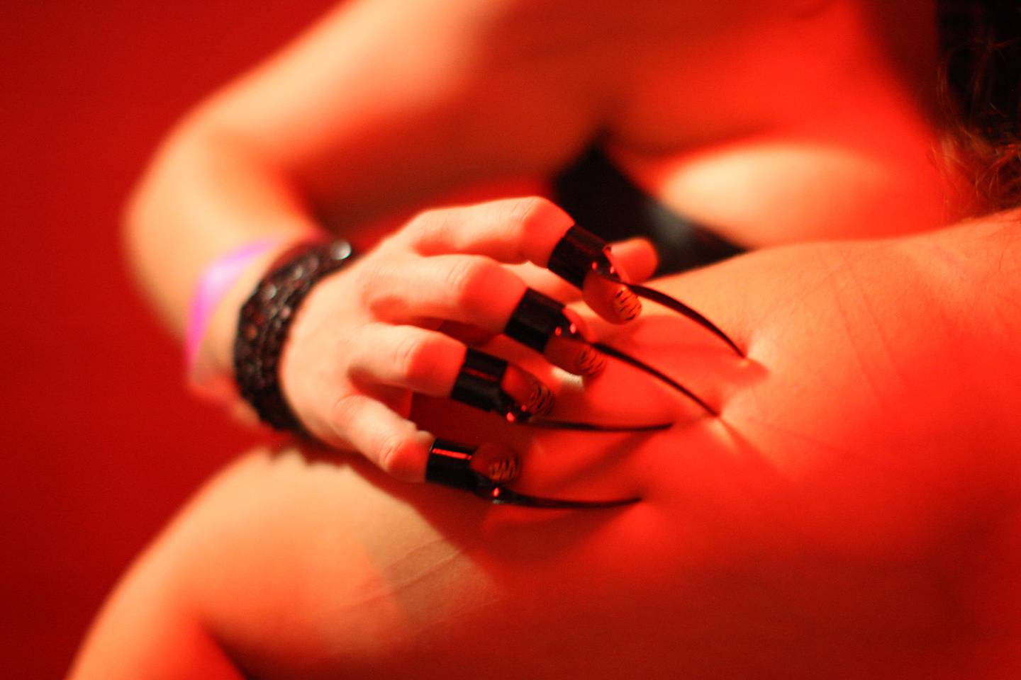 LOS ANGELES, CA - MAY19: Mistress drags metal claws over the skin of Katie who is a willing submissive at a dungeon party during the DomConLA convention in the early morning hours of May 19, 2012 in Los Angeles, California. DomCon brings together enthusiasts of BDSM (Bondage, Discipline, Submission and Dominance) and other sexual fetishes. The convention, started in 2003 by fetish professional, Mistress Cyan, is claimed to be the largest convention of its kind in the U.S. DomConLA will continue through May 20.   David McNew/Getty Images/AFP