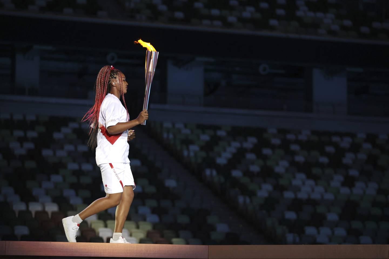 Naomi Osaka fikk æren av å tenne OL-ilden i hjemlandet Japan. Foto: Hannah McKay / Pool Photo via AP / NTB
