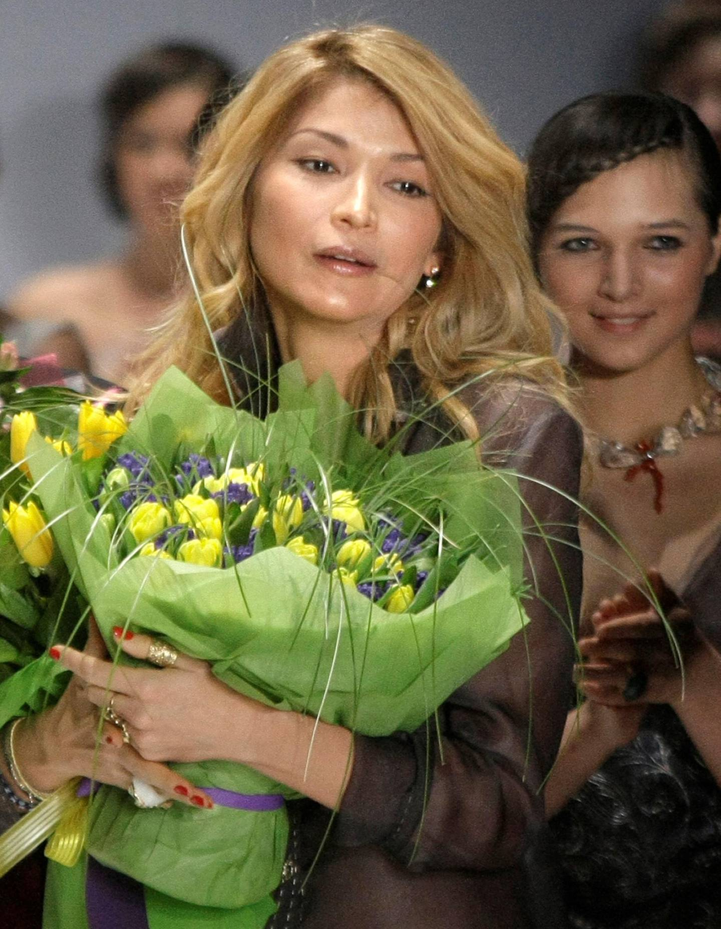 FILE - In this Saturday, April 2, 2011 file photo, Gulnara Karimova  photographed  just after a display of creations of 'Guli' collections at the Fashion Week in Moscow, Russia. Swiss authorities have opened a money laundering investigation into the eldest daughter of Uzbekistan's authoritarian president, Islam Karimov, related to that country?s telecommunications market, Switzerland?s attorney general?s office said Wednesday March 12, 2014. The investigation into Gulnara Karimova, a glamorous and wealthy diplomat, pop singer and businesswoman, also has triggered new leads abroad, particularly in Sweden and France, the prosecutors? office in the Swiss capital Bern said in a statement.  (AP Photo/Mikhail Metzel, file)