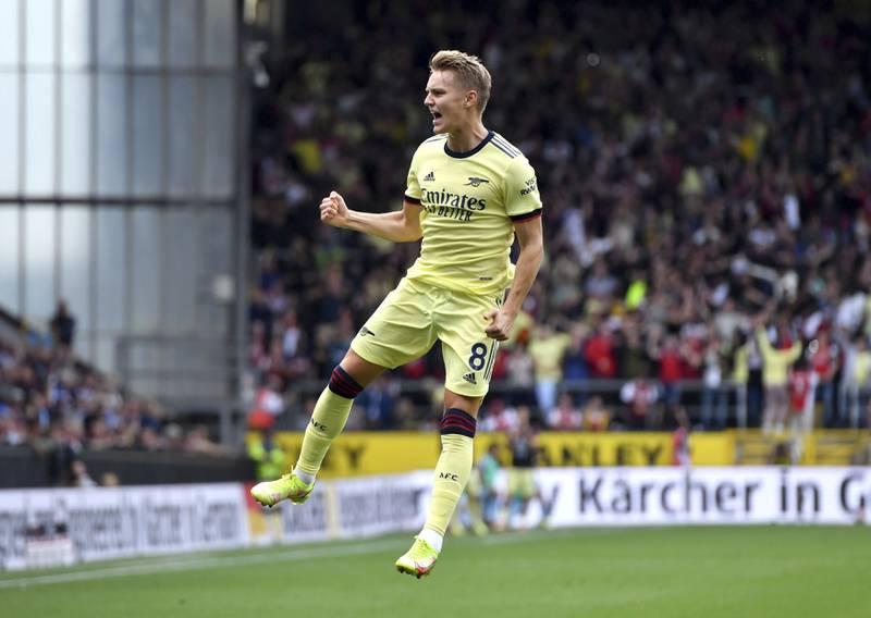 Martin Ødegaard jubler etter å ha sendt Arsenal i ledelsen med en frisparkperle. Foto: Anthony Devlin / PA via AP / NTB