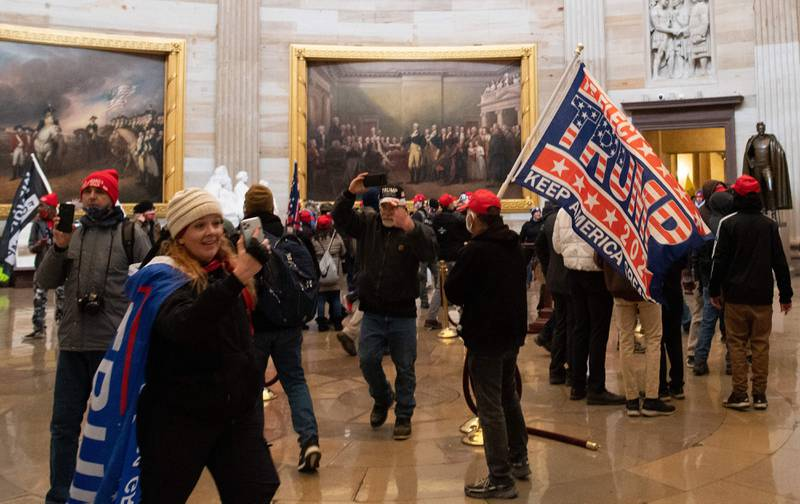Supporters of US President Donald Trump enter the US Capitol's Rotunda on January 6, 2021, in Washington, DC. - Demonstrators breeched security and entered the Capitol as Congress debated the a 2020 presidential election Electoral Vote Certification. (Photo by SAUL LOEB / AFP)