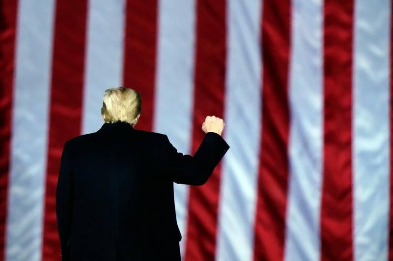President Donald Trump gestures at a campaign rally in support of U.S. Senate candidates Sen. Kelly Loeffler, R-Ga., and David Perdue in Dalton, Ga., Monday, Jan. 4, 2021. (AP Photo/Brynn Anderson)