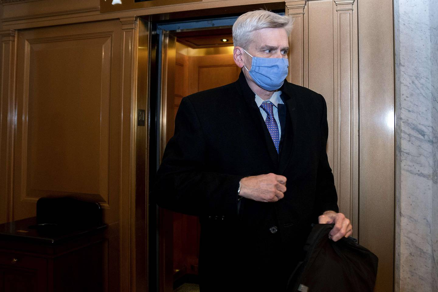 WASHINGTON, DC - FEBRUARY 13: Sen. Bill Cassidy (R-LA) wears a protective mask while departing the U.S. Capitol on February 13, 2021 in Washington, D.C. Former President Donald Trump's second impeachment trial ended in a not guilty verdict on a vote of 57-43, short of the two-thirds majority required.   Stefani Reynolds-Pool/Getty Images/AFP == FOR NEWSPAPERS, INTERNET, TELCOS & TELEVISION USE ONLY ==