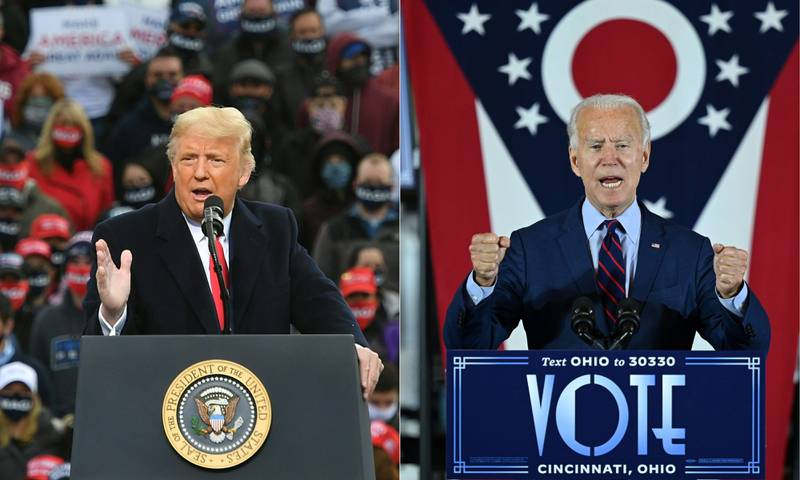 (COMBO) This combination of pictures created on October 30, 2020 shows US President Donald Trump speaks during a campaign rally at Manchester-Boston Regional Airport in Londonderry, New Hampshire on October 25, 2020. Democratic Presidential candidate and former Vice President Joe Biden delivers remarks at a voter mobilization event in Cincinnati, Ohio, on October 12, 2020, where he will speak to the importance of Ohioans making their voices heard this election. (Photos by MANDEL NGAN and JIM WATSON / AFP)