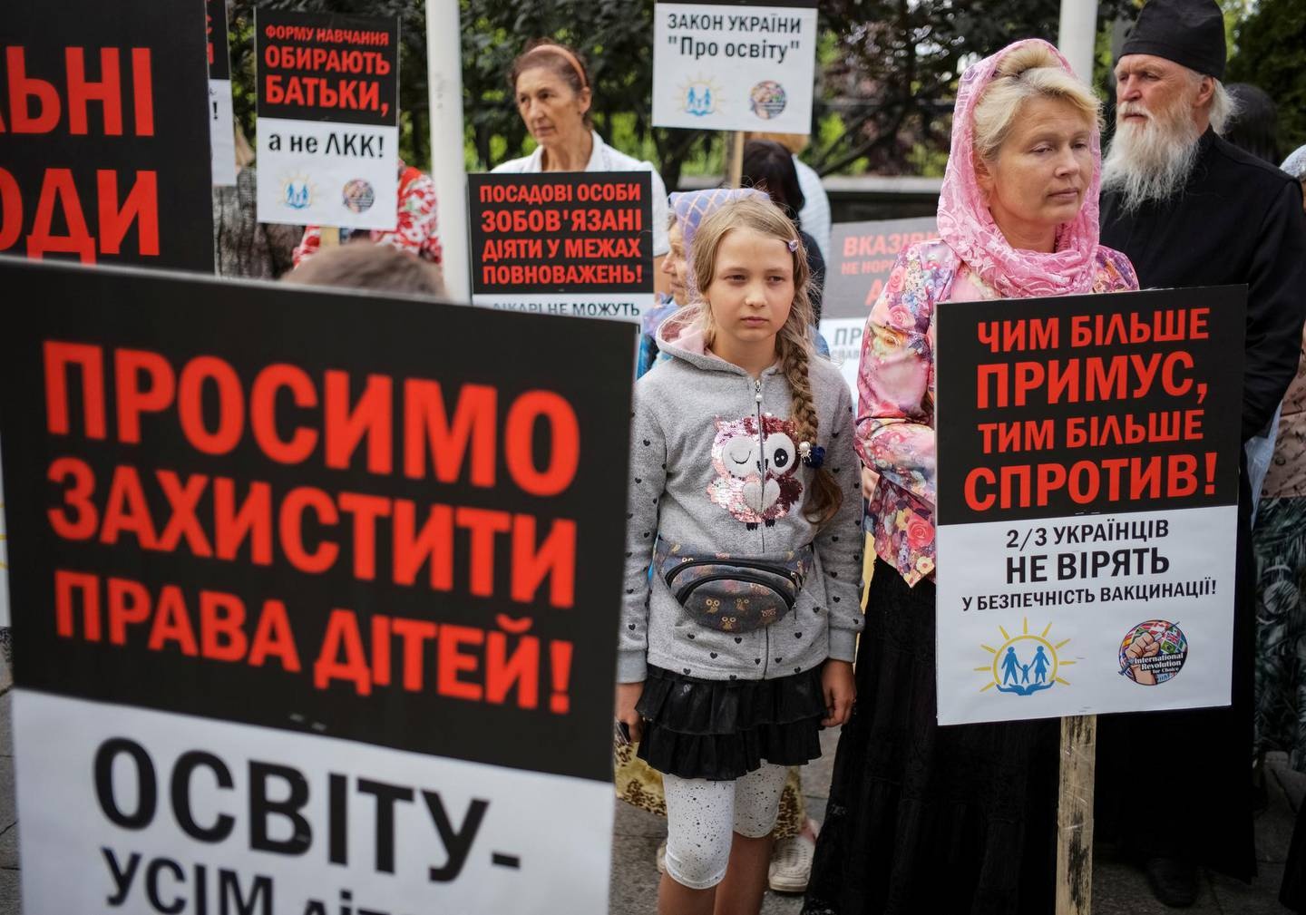 FILE PHOTO: Anti-vaccination activists protest against the decision of the Health Ministry and Education Ministry to not allow children without vaccination to go to kindergarten and school, next to the Presidential Administration building in Kiev, Ukraine August 22, 2019.  Picture taken August 22, 2019.  REUTERS/Gleb Garanich/File Photo