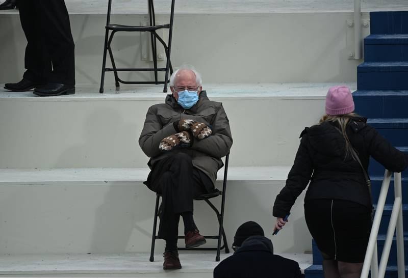 TOPSHOT - Former presidential candidate, Senator Bernie Sanders (D-Vermont) sits in the bleachers on Capitol Hill before Joe Biden is sworn in as the 46th US President on January 20, 2021, at the US Capitol in Washington, DC. (Photo by Brendan SMIALOWSKI / AFP)