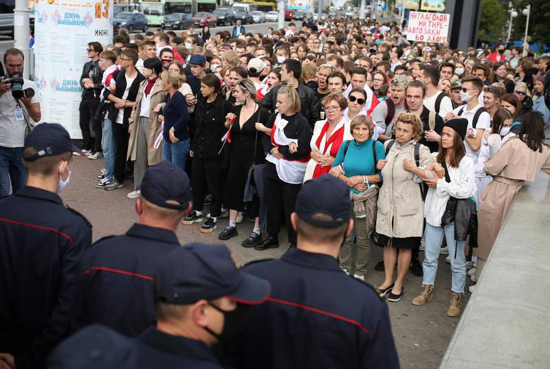 Belarusians attend a rally in Minsk, Belarus, Tuesday, Sept. 1, 2020. Several hundred students on Tuesday gathered in Minsk and marched through the city center, demanding the resignation of the country's authoritarian leader after an election the opposition denounced as rigged. Many have been detained as police moved to break up the crowds. (Tut.By via AP)