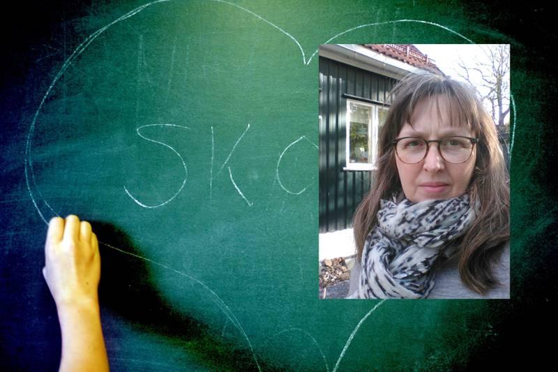 2006 Glad i skolen. Skole med hjerte rundt. Tegnet på tavlen. Hånd. Grønn tavle. Foto: Sara Johannessen / Scanpix