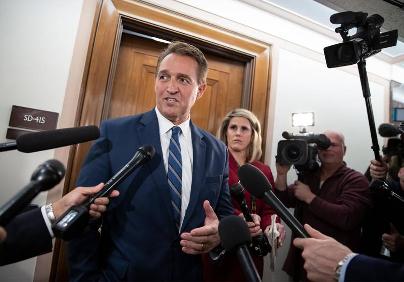 FILE- In this Dec. 6, 2018, file photo, Sen. Jeff Flake, R-Ariz., speaks with reporters on Capitol Hill in Washington.  President Donald Trump?Äôs most prominent GOP critics on Capitol Hill are days away from completing their Senate careers, raising the question of who will take their place as willing to publicly criticize a president who remains popular with Republican voters. Sens. Jeff Flake of Arizona and Bob Corker of Tennessee engaged in a war of words with the president on myriad issues over the past 18 months, generating headlines and fiery tweets from a president who insists on getting the last word. (AP Photo/J. Scott Applewhite, File)