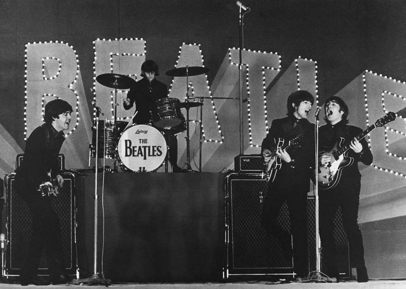 (FILES) In this file photo taken on June 29, 1966 This photo taken on June 30, 1966 shows British band The Beatles, (L to R) Paul McCartney, Ringo Starr, George Harrison and John Lennon, performing during their concert at the Budokan in Tokyo. - John Lennon's career was cut short 40 years ago, on December 8, 1980, when he was shot dead in New York. (Photo by - / JIJI PRESS / AFP) / Japan OUT