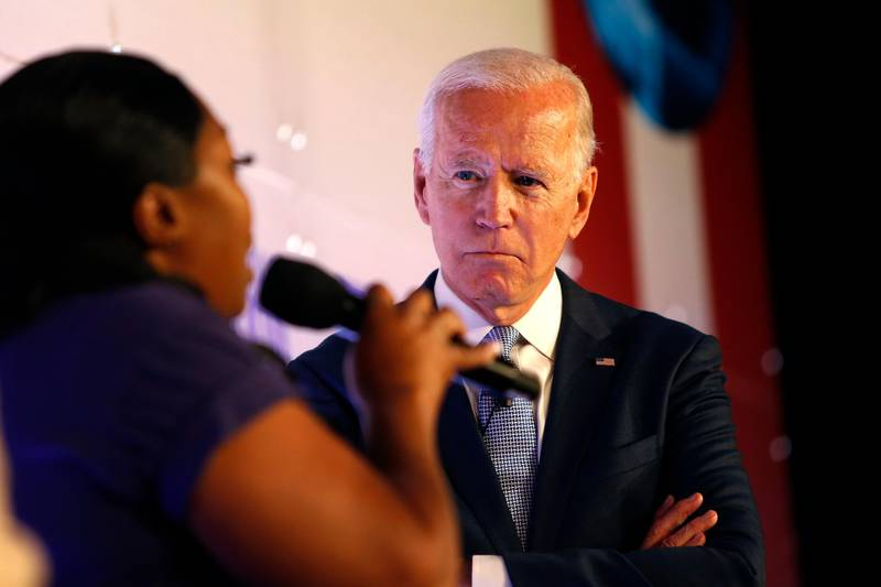 Former Vice President and Democratic presidential candidate Joe Biden waits to speak at the SEIU Unions For All Summit on Friday, Oct. 4, 2019, in Los Angeles. (AP Photo/Ringo H.W. Chiu)