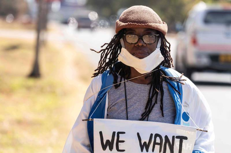 Zimbabwean novelist Tsitsi Dangarembga holds a placard during an anti-corruption protest march along Borrowdale road, on July 31, 2020 in Harare. - Police in Zimbabwe arrested on July 31, 2020 internationally-aclaimed novelist Tsitsi Dangarembga as they enforced a ban on protests coinciding with the anniversary of President Emmerson Mnangagwa's election. Dangarembga, 61, was bundled into a police truck as she demonstrated in the upmarket Harare suburb of Borrowdale alongside another protester. (Photo by ZINYANGE AUNTONY / AFP)