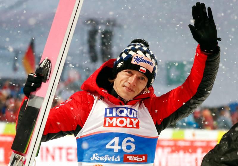 Poland's Dawid Kubacki celebrates winning the Ski Jumping HS109, at the Nordic Ski World Championships in Seefeld, Austria, Friday, March 1, 2019. (AP Photo/Matthias Schrader)