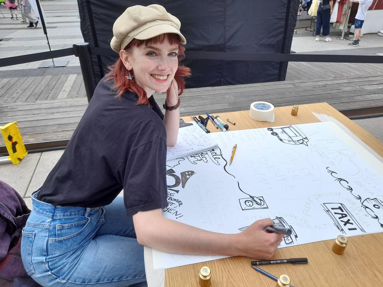 Aurora Wilde fra Moss spør folk hva de ønsker seg i byen, og tegner det.