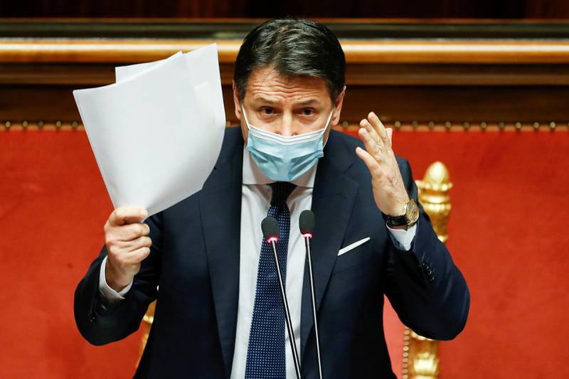 FILE PHOTO: Italian Prime Minister Giuseppe Conte gestures as he speaks ahead of a confidence vote at the upper house of parliament after former Prime Minister Matteo Renzi pulled his party out of government, in Rome, Italy, January 19, 2021. REUTERS/Yara Nardi/Pool/File Photo