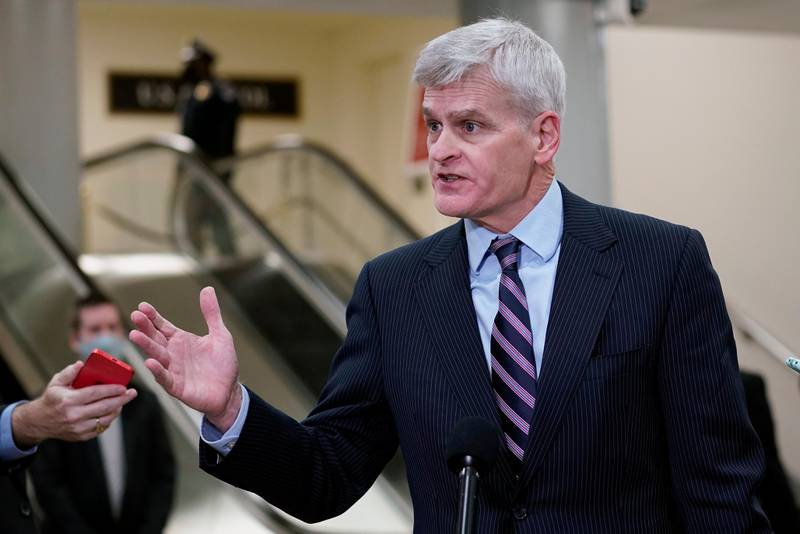 Sen. Bill Cassidy, R-La., talks with reporters on Capitol Hill in Washington, Wednesday, Feb. 10, 2021, as he heads to the second day of the second impeachment trial of former President Donald Trump. (AP Photo/Susan Walsh)