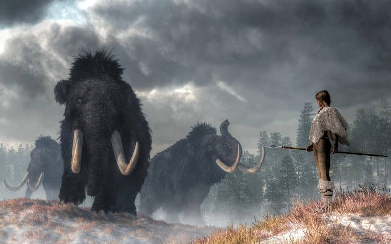 In a prehistoric wilderness, a woman faces the Gods of Winter.  Three woolly mammoths emerge from the cold Pleistocene mists. The woman, dressed in white fur, holds a spear at her side. 3D Rendering