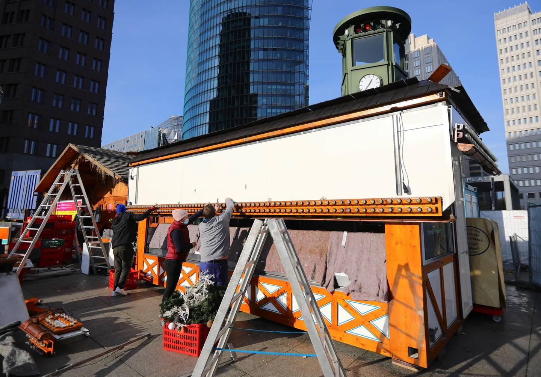 Workers dismantle Christmas stands at Potsdamer Platz admit the coronavirus disease (COVID-19) outbreak in Berlin, Germany, November 24, 2020. REUTERS/Hannibal Hanschke