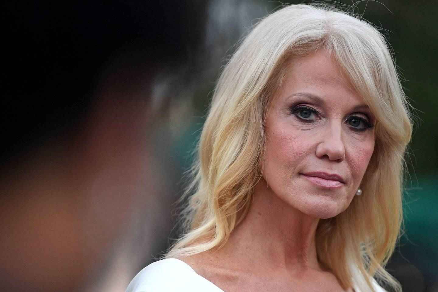 """(FILES) In this file photo taken on August 26, 2020 Counselor to the President Kellyanne Conway speaks with the press at the White House in Washington, DC. - Former Counselor to the US President Kellyanne Conway said on October 2, 2020 that she has tested positive for Covid-19. President Donald Trump was hospitalized on October 2 and given an experimental Covid-19 treatment, but said he was """"well,"""" following bombshell news that the Republican had contracted the virus, knocking him off the campaign trail a month from the US election. (Photo by Eric BARADAT / AFP)"""