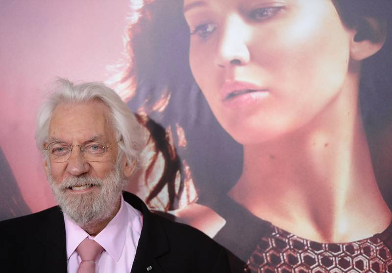 """Donald Sutherland arrives for the Los Angeles premiere of """"The Hunger Games: Catching Fire"""" is seen at the Nokia Theatre LA Live in Los Angeles, California, November 18, 2013.  AFP PHOTO / Robyn Beck"""