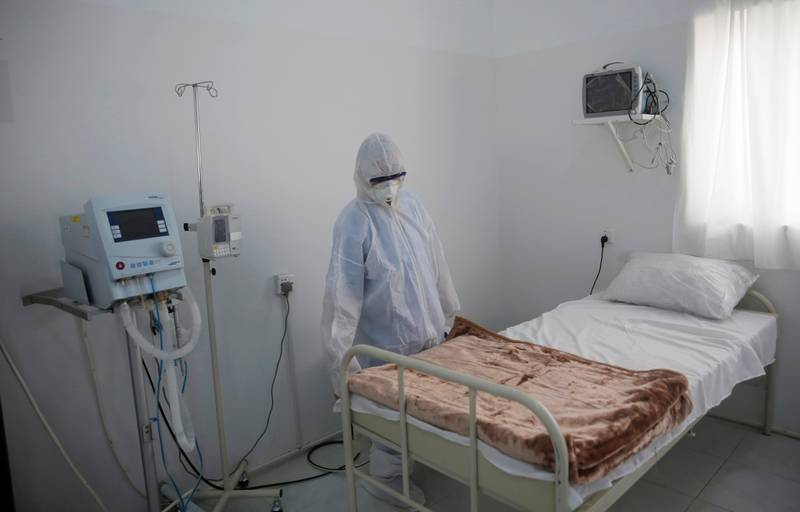 A medical staff member works on setting up an isolation room at a coronavirus quarantine ward at a hospital in Sanaa, Yemen, Sunday, March 15, 2020. (AP Photo/Hani Mohammed)