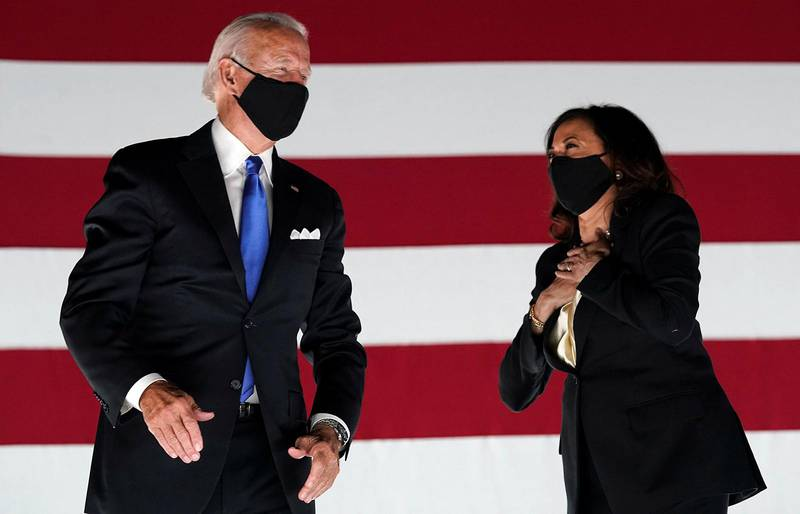 FILE PHOTO: Democratic presidential candidate and former Vice President Joe Biden and U.S. Senator and Democratic candidate for Vice President Kamala Harris celebrate after Joe Biden accepted the 2020 Democratic presidential nomination during the 4th and final night of the 2020 Democratic National ConventioN U.S. August 20, 2020. REUTERS/Kevin Lamarque/File Photo