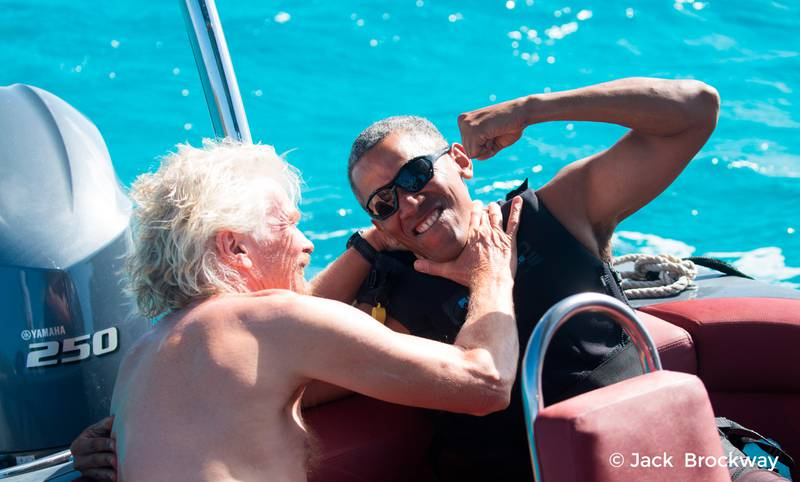 In this recent but undated photo made available by Virgin.com, former U.S President Barack Obama, jokes with Richard Branson, founder of the Virgin Group, during his stay on Moskito Island, British Virgin Islands. The former president and his wife stayed on Mosikto Island owned by Richard Branson, founder of the Virgin Group, after he finished his second term as President and left the White House. (Jack Brockway/Virgin.com via AP)