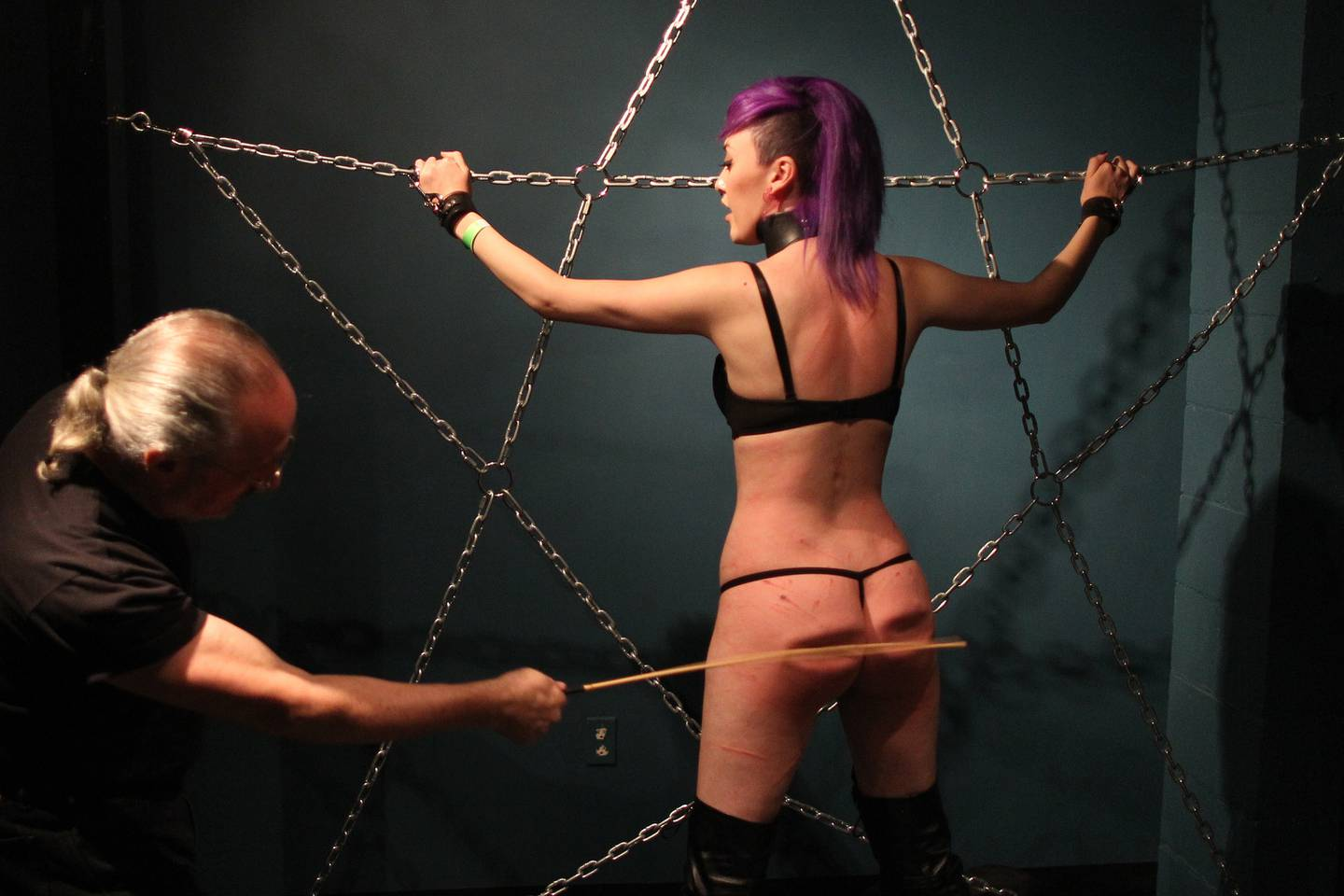 Redlines ties up and suspends voluntary submissive Mermaid at a dungeon party during the DomCon LA domination convention on May 21, 2016 in Los Angeles, California.