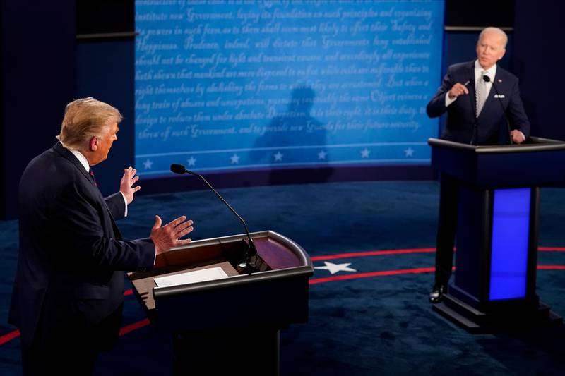 U.S. President Donald Trump and Democratic presidential nominee Joe Biden participate in their first 2020 presidential campaign debate held on the campus of the Cleveland Clinic at Case Western Reserve University in Cleveland, Ohio, U.S., September 29, 2020. Morry Gash/Pool via REUTERS