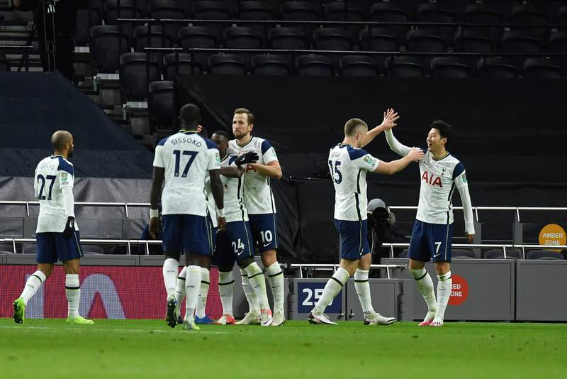 Tottenham's Son Heung-min, right, celebrates with teammates after scoring his side's second goal during the EFL Cup semi-final soccer match between Tottenham Hotspur and Brentford at Tottenham Hotspur Stadium in London, England, Tuesday, Jan. 5, 2021. (Glyn Kirk/Pool via AP)