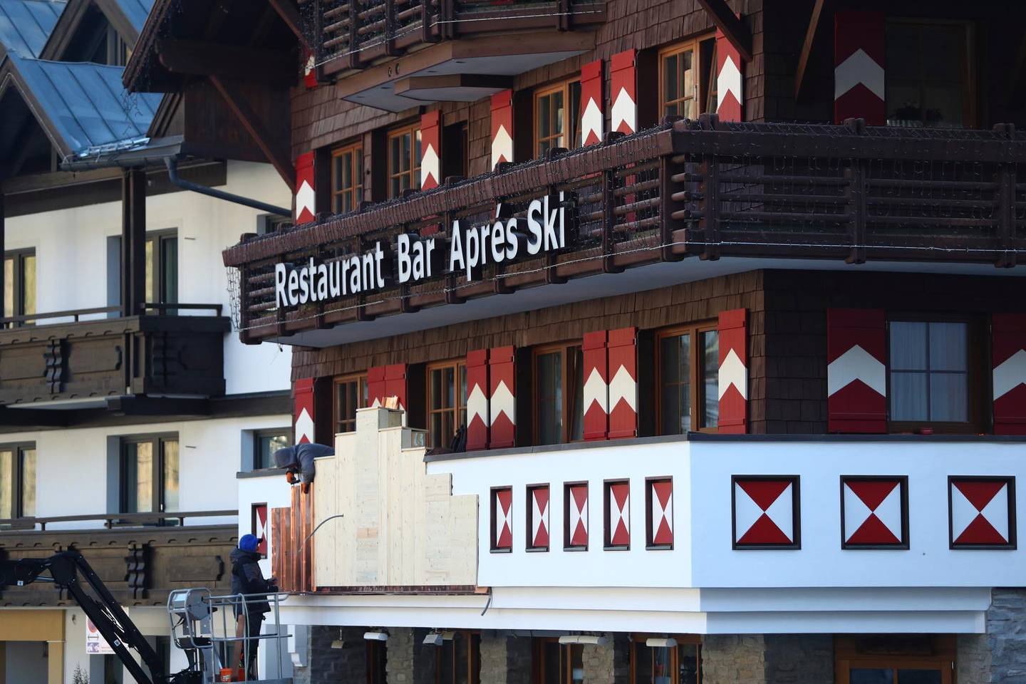 Worker prepare a balcony at a restaurant and bar in Ischgl, Austria, Thursday, Nov. 26, 2020. The Austrian government imposed a second lockdown to slow down the ongoing pandemic of the COVID-19 disease caused by the SARS-CoV-2 coronavirus from Nov. 17, 2020 until at least Dec. 6, 2020. (AP Photo/Matthias Schrader)