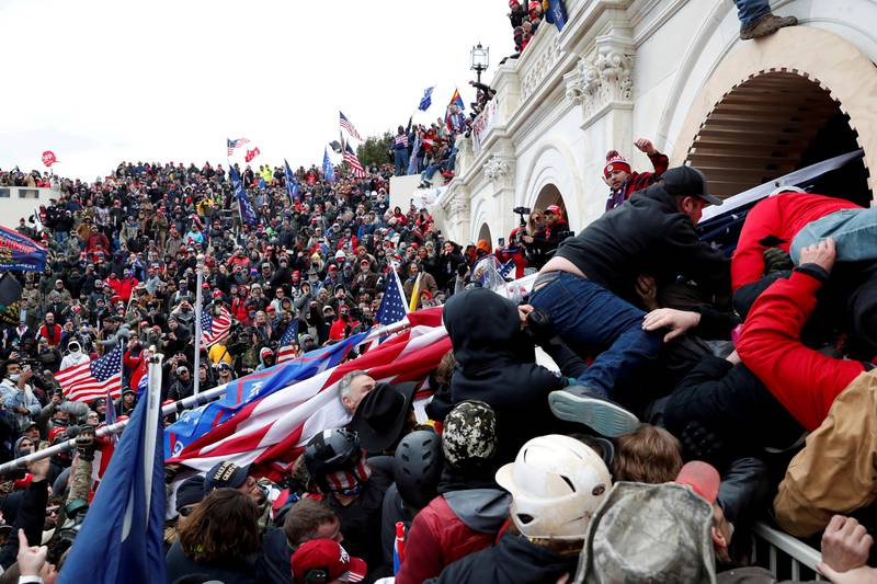 FILE PHOTO: Pro-Trump protesters storm into the U.S. Capitol during clashes with police, during a rally to contest the certification of the 2020 U.S. presidential election results by the U.S. Congress, in Washington, U.S, January 6, 2021. REUTERS/Shannon Stapleton/File Photo