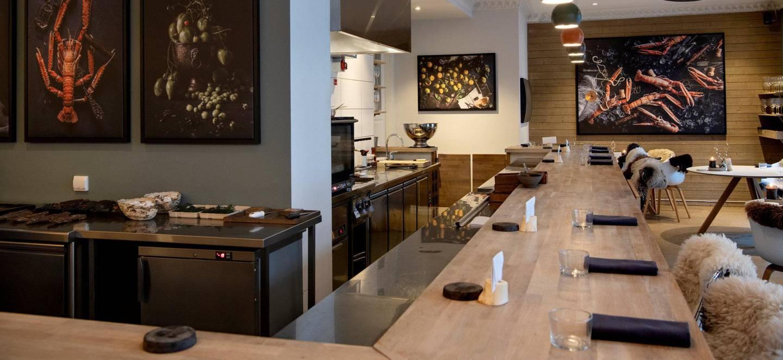 Bokbacka. Restaurant på Frogner. Byløvene.   Fotografi på veggene av Mats Dreyer.
