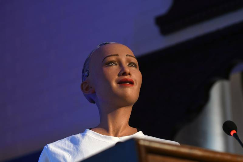 Humanoid robot Sophia speaks at a conference on using technology for public services in Kathmandu on March 21, 2018. Sophia, a robot created by Hanson Robotics, was named by UNDP as its first non-human Innovation Champion, in November 2017. / AFP PHOTO / PRAKASH MATHEMA